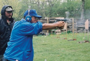 Ayoob demonstrates the G18 machine pistol on full auto. There are six spent casings in the air. Click the image to read a free article by Mas Ayoob, courtesy of Gun Digest and Tactical Gear.
