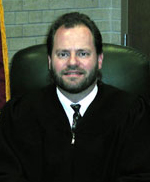 Clark County Judge Jon Counsell rules concealed carry ban unconstitutional.